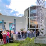 people line up outside harn museum of art