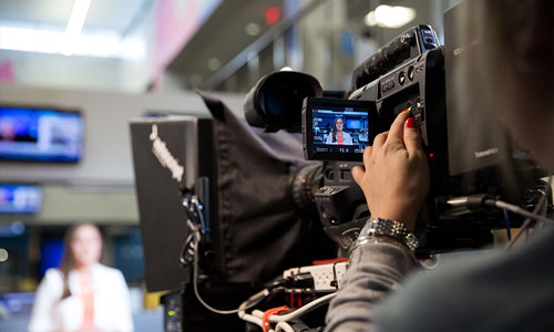 A news camera and teleprompter
